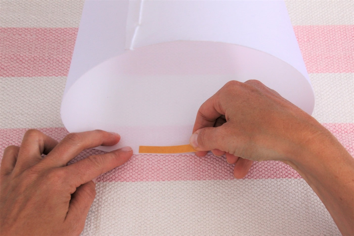 Lay the school bag blank with adhesive tape